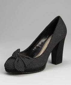 Keep steps sweet yet sassy with these playful polka dotted pumps. This darling pair features a sturdy heel and bow atop the toe for extra style points. 3.5'' heel with 0.5'' platformFabric upperMan-made soleImported