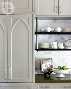 Interior: Cozy Euro chic Gothic panel on the fridge suspended shelves nickel hardware marble subway tile. Via House and Home. The post Interior: Cozy Euro chic appeared first on House ideas. Kitchen Interior, Kitchen Design, Kitchen Decor, Studio Interior, Diy Kitchen, Kitchen Ideas, Cuisine Tudor, Style At Home, Home Design