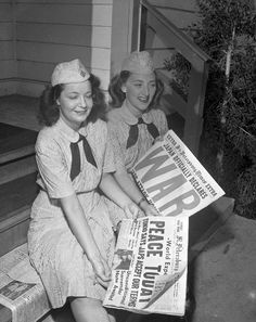 Women reading a news article about Victory over Japan (VJ) Day, August 1945.