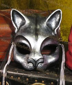 Silver cat mask by goblinart, via Flickr