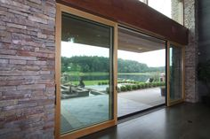 Easy transition between the outdoors and the living room, made possible by these lift-and-slide glass doors. | to see more of the project, visit http://studioduo.net