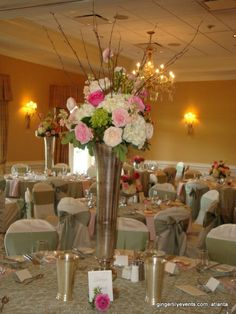 Tall floral centerpieces for a brunch wedding in Atlanta. Marietta Country Club. Large pink roses with white hydrangeas and greenery. Mercury vases. Sea green chair ribbons #gingerlilyevents #atlantaflorist #wedding #tabledecor
