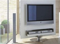 Modern TV Stand with elegant white design with flexible unit that combines a TV wall with a comfortable working desk. TV Stands by Gruber Schlager is suitable to be placed in your office or work space office room in your home.