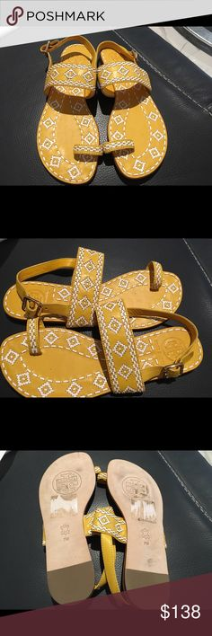 """Tory Burch Reena flats leather shoes Authentic brand new Tory Burch Reena features Tribal texture on decorative footbed. It has leather comfy adjustable strap with buckle and toe ring 1/4"""" heel size 7. Tory Burch Shoes Sandals"""