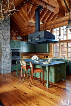Beautiful rustic cabin kitchen in green!