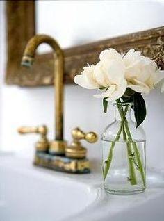 Fresh flowers and worn brass!