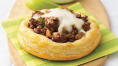 Make and bake individual bowls out of refrigerated buttermilk biscuits, then spoon in a meaty sauce for this hearty dish.