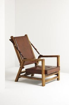 Jacques Adnet; Elm, Leather and Brass Armchair, c1949.