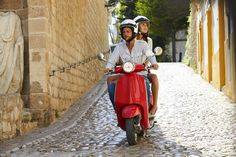 On a red #moped along the #cobble-stone streets of #Florence Italy - now how much more romantic can it get?!? www.fastcover.com.au
