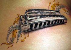 silver harmonica tattoo by Stefano of New York City, NY