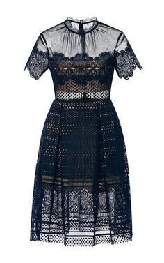 A delicate, ultra-feminine evening piece, this **Self Portrait** dress is crafted in black lace with a stretch nude lining.