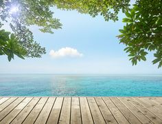 Beauty tropical seascape on background blue cloud sky. View from wood pier
