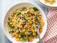 Ina's Confetti Corn : Ina's colorful side dish combines sweet corn and peppers with fresh herbs.