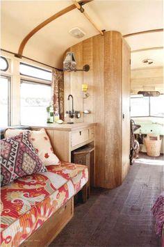 Campervan interior design: Washed wood, cream, natural light, paisley prints.