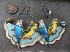 Tin parrot earrings...cut from vintage tin box(es)...oh my goodness, I love this ides! :)