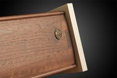 Although this is a picture of a walnut drawer and ours were cherry you can see the solid curved detailing and giant dovetail.  They are the most gorgeous drawer boxes ever.