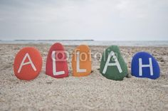 Allah is great. Colourful stones composition on the beach