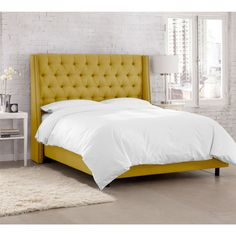 Ardenne Tufted Swoop Bed in French Yellow.