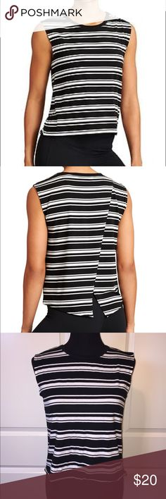 "Athleta Serenity Sleeveless Top Athleta Serenity sleeveless top. Black and white striped top. Cute cross over open back. Hi-low hem. Perfect for workouts or wearing on a hot summer day. Very cute top. 80% lyocell/13% silk/7% spandex. 19"" front. 23"" back. Size S. Athleta Tops"