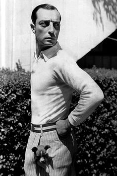 Is that a dog in your pocket or are you just happy to see me? Buster Keaton and puppy