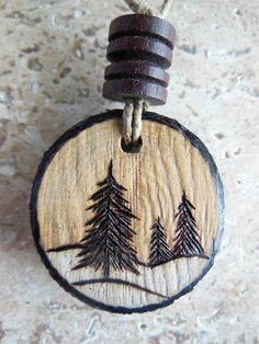 "Each of my woodburned ornaments is handmade with a slice of maple wood.  There are 4 available of this style, each slightly different. This listing is for ONE of the 4 pine/Christmas tree design ornaments.  This ornament is approximately 1"" in diameter and 1/4"" thick.  It is strung on a wax..."