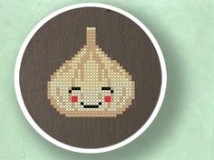 Quite possibly the cutest cross stitched head of garlic ever. #cross #stitch #cute #crafts #kawaii #garlic #food