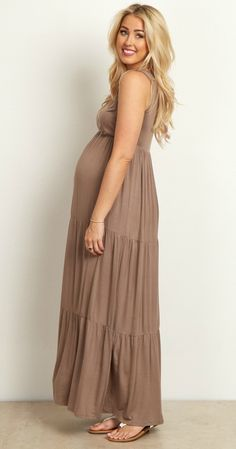 Nothing beats a bohemian maternity maxi dress like this! A gorgeous hue and layered detail for effortless style, and a v-neckline to make nursing after pregnancy easy. This maternity maxi dress is beautiful by itself, or paired with sandals and a necklace for a complete look.