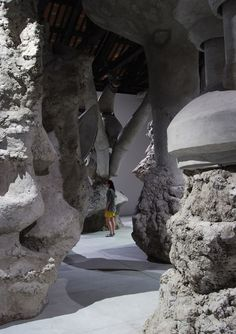 """Adrián Villar Rojas, """"The Murderer of Your Heritage"""", installation at the 54th annual Venice Biennale contemporary art exhibition. The site-specific structure took nearly two months to be assembled by a team of sculptors, builders and engineers and is made from clay, cement, burlap and wood. Based around a theory of multi-universes, where many different universes could co-exist at once, the sculpture calls attention to the multiple paths humans could have taken throughout our history."""