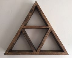 Triangle shelf made from 100% reclaimed wood and finished in a stunning dark oak oil which highlights the grain.  Wall mounted or free standing All natural materials and made from reclaimed and repurposed wood giving life back to a once useful resource Measurement are approximately 15 inches from tip to tip and 2.5 inches deep.  If you would like to make your own shape please contact me for a custom design :) Caroline LoveLifeWood