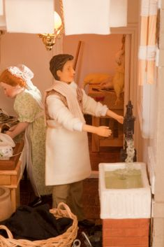 FEATHERSTONE HALL HOTEL STORY - In the laundry and washroom Katie the scullery maid is washing up the first batch of dinner dishes, while John pumps water to put some stained jackets in to soak.