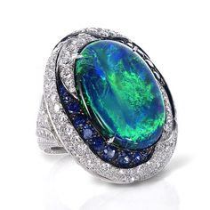 LEVIEV's Black Opal, Sapphire and Diamond Ring totaling 23.71 carats, handcrafted in platinum.