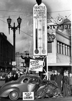 "his ""Death Thermometer"" was placed at the intersection of 4th and Westlake in 1940 by the Seattle Traffic and Safety Council. The little boy atop the care was 'Safety Pete', the official mascot. Via Vintage King County Washington on Facebook."