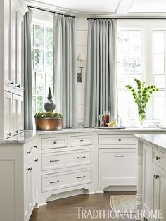 Kitchen curtains (instead of the more predictable Romans) let in more light.