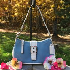 COACH LEATHER Small Handbag. Gorgeous!! Guaranteed authentic or your money is refunded in full. Beautiful 100% genuine leather Coach bag. Baby blue w/ white trim. Pic #3 shows the bag next to a reg. size 12oz pop can for a visual size comparison. Zipper closure on bag. Bag has flat reinforced bottom so it's roomy for its size. Easily holds small Wallet, cell phone, make up and other goodies. Bag is in new condition. Used one time. Perfect shows no wear. Paid $299. Absolutely gorgeous bag…