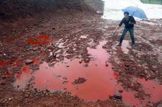 This Chinese river is turning red again. Can you guess why?