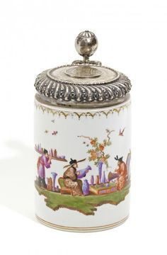"""""""Walzenkrug"""" Tankard with Chinese Figures.   Meissen. Circa 1730.     Porcelain, enriched in colours and gold. Silver lid and mountings. Smooth, cylindrical form.  dated 1608. Height 19,5cm."""