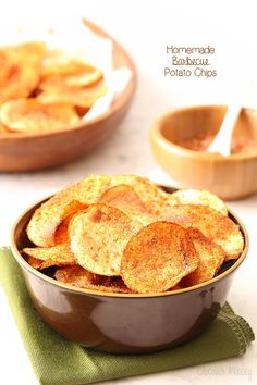 Crispy homemade potato chips tossed in a spicy barbecue seasoning are easier to make at home than you think! Recipes for baked potato chips and fried potato chips provided.