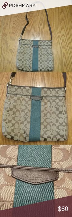 Coach crossbody brown tan and dark teal No e1432-f28502 Has 2 pen marks inside of bag barely noticeable  One white mark on back of bag not very noticeable  In great shape other wise Bag 11in long 12in wide Strap drop 18in Bags Crossbody Bags