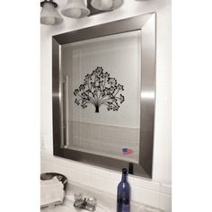 Add sophistication to your home decor with this decorative wall mirror. Available in a variety of sizes, this beveled glass mirror features an elegant silver frame and includes all necessary hanging hardware for vertical or horizontal display.