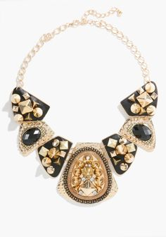 I like the mixture of studs and sparkle. The gold and the black would be a good color combo for the packaging. -ashley