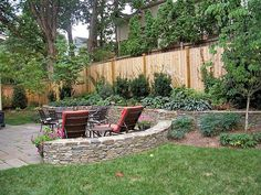 retaining wall--wonder if this half-circle part would work by our pond