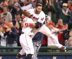 Cleveland Indians Mike Aviles is picked up by Nyjer Morgan after Aviles knocked in Asdrubal Cabrera with the winning run in the bottom of the 9th inning to beat the Minnesota Twins 4-3 on May 7, 2014 at Progressive Field.   (Chuck Crow/The Plain Dealer)