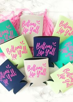 """elle & k boutique exclusive koozies featuring """"Bottoms Up Y'all"""" on the front and the elle & k logo on the back. Available In: Navy, Lime, Emerald & Sand - Hot Pink Imprint Color Standard koozie size."""