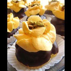 ... glazed in dark chocolate ganache and topped with orange flower water