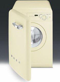 A washing machine hid behind a door that looks like a mini fridge. I'll take one in red please!