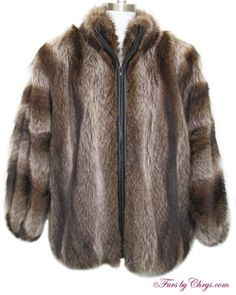 Raccoon Fur Bomber Jacket #R701; $600; Excellent Condition; Size range: 10 - 16. This is a striking genuine raccoon fur bomber jacket. It has a Bloomingdale's Northern Lights label, and features gorgeous large dolman sleeves and a small stand-up-style collar. The lining is solid black and there is NO MONOGRAM. It has a zipper closure. When you're wearing this gorgeous raccoon jacket while running errands or out on the town, you will be snug, warm and looking hot!