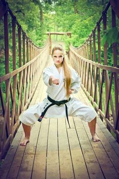 In Japanese martial arts, the horse stance (kiba-dachi) has many minor variations between individual schools, including the distance between the feet, and the height of the stance. One constant feature is that the feet must be parallel to each. Kyokushin Karate, Karate Shotokan, Martial Arts Belts, Martial Arts Women, Aikido, Taekwondo, Kendo, Karate Photos, Karate Picture