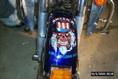 Harley fender.  Customer did his own paint job, I added the art. Done with pin striping brushes.