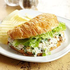 Lemon juice, fresh green onion, and parsley keep this basic chicken salad far from ho-hum. Try it over greens for a dinner salad or sandwiched between your favorite bread or roll for a simple meal.