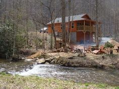 "'YELLOW CREEK CABIN' A very secluded creek side cabin within 14 miles of Robbinsville. Come to ""Yellow Creek Cabin"" and step back in time while preserving all of the conveniences of home. Located on a private road, ..."